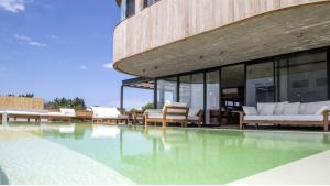 Cozy Modern House in Town located in Jose Ignacio, Punta del Este, Uruguay, listed by Curiocity Villas.