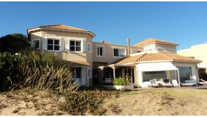 Amazing Beachfront Villa Excellent Location located in Manantiales, Punta del Este, Uruguay, listed by Curiocity Villas.