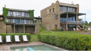 Outstanding Private House Complex  located in El Chorro, Punta del Este, Uruguay, listed by Curiocity Villas.