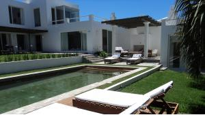 Charming Ocean View Villa  located in La Barra, Punta del Este, Uruguay, listed by Curiocity Villas.