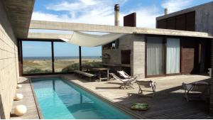 Beachfront Modern Villa located in Jose Ignacio, Punta del Este, Uruguay, listed by Curiocity Villas.